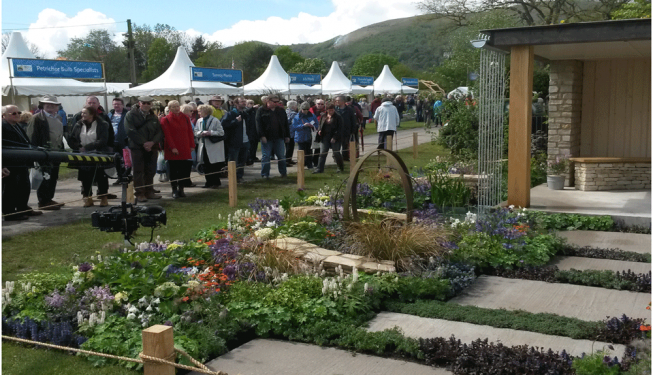 Malvern show garden with visitors admiring the garden