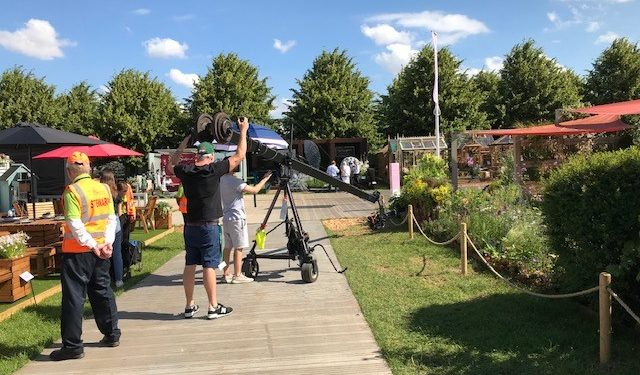 TV crew filming the sensory show garden