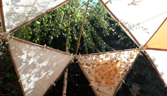 Fun garden shelter decorated by children with fabric panels